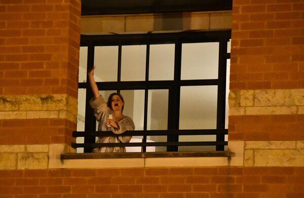 Žena vyjádřuje svou podporu protestujícím lidem ve Washingtonu - Sputnik Česká republika