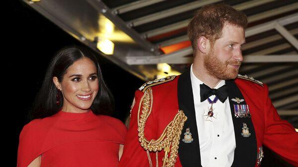 In this Saturday March 7, 2020 file photo, Britain's Prince Harry and Meghan, Duchess of Sussex arrive at the Royal Albert Hall in London. Meghan, Duchess of Sussex has her first post-royal job: narrating a Disney documentary about elephants - Sputnik Česká republika