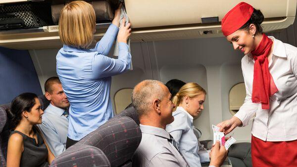 Cestující v letounu. Ilustrační foto - Sputnik Česká republika