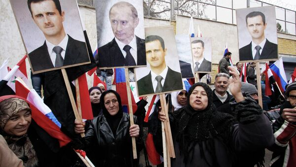 Fotografie Bašára Asada a Vladimira Putina - Sputnik Česká republika