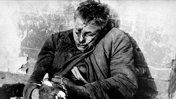 Slavná fotografie chlapce Viktora Čerevičkina držícího holubici, který byl zabit nacisty - Sputnik Česká republika