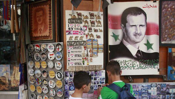 Suvenýry s portrétem Bašára Asada - Sputnik Česká republika