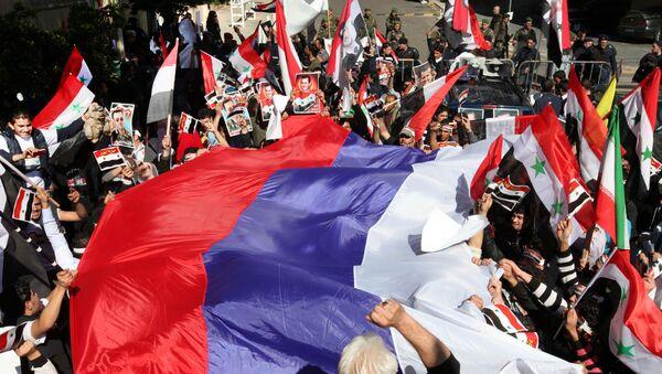 Ruská vlajka během akce v Libanonu - Sputnik Česká republika
