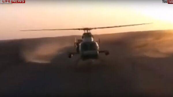 Pilot vojenského vrtulníku v Iráku se ukázal před kolegy - Sputnik Česká republika