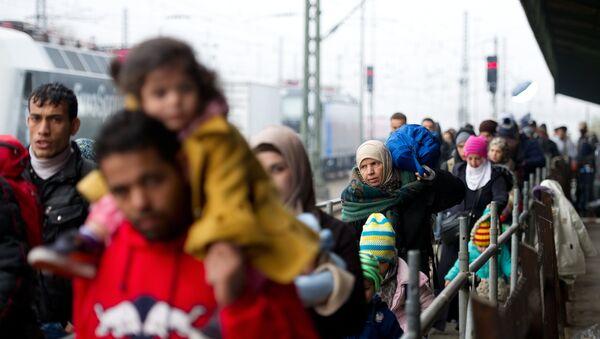 Migranti v Düsseldorfu - Sputnik Česká republika