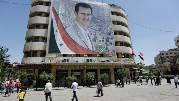 Portrét Bašára Asada v Damašku - Sputnik Česká republika