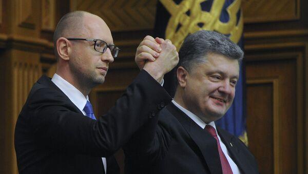 Ukrajinský prezident Petro Porošenko a ukrajinský premiér Arsenij Jaceňuk - Sputnik Česká republika