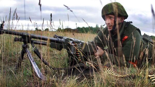Litevský voják během cvičení Saber Strike 2014 - Sputnik Česká republika