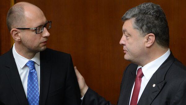 Arsenij Jaceňuk a Petro Porošenko - Sputnik Česká republika