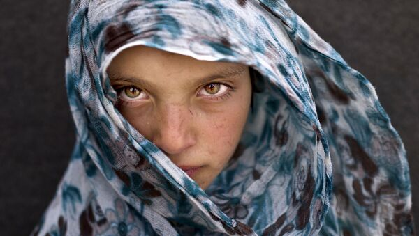 Mladá syrská uprchlice ve stanovém táboře v Jordánsku - Sputnik Česká republika