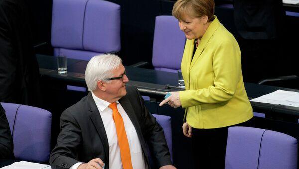 Frank-Walter Steinmeier a Angela Merkelová - Sputnik Česká republika