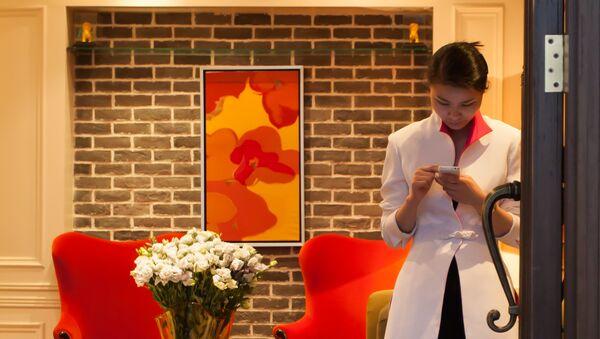Čínská dívka s chytrým telefonem - Sputnik Česká republika