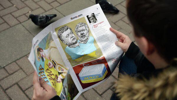 Сhlap čte karikaturní časopis - Sputnik Česká republika