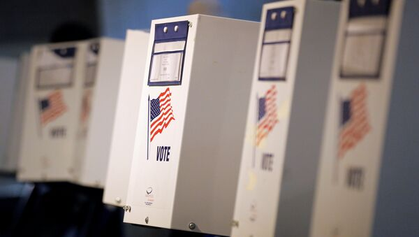 Voting booths are seen during the New York primary elections at a polling station in the Brooklyn borough of New York City, U.S., April 19, 2016. - Sputnik Česká republika