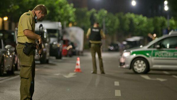 Německá policie na místě teroristického činu, Ansbach, 24. 7. 2016. - Sputnik Česká republika