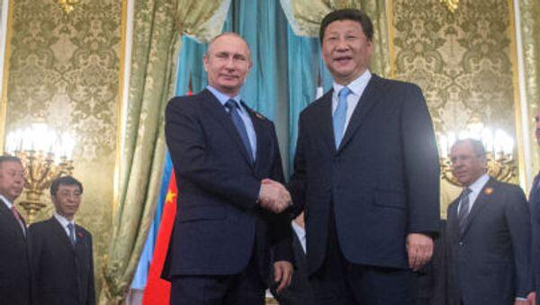 Ruský prezident Vladimir Putin a čínský prezident Si Ťin-pching, 08.05.2015 - Sputnik Česká republika