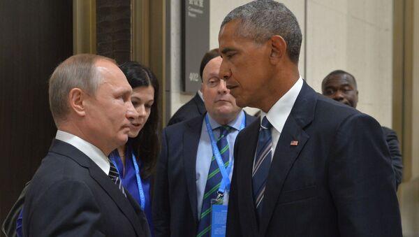 Prezident RF Vladimír Putin během setkání s americkým kolegou Barackem Obamou - Sputnik Česká republika
