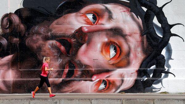 Běžkyně na nábřeží ve Vídni, ilustrační foto - Sputnik Česká republika