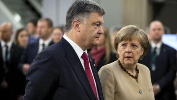 Petro Porošenko a Angela Merkelová - Sputnik Česká republika