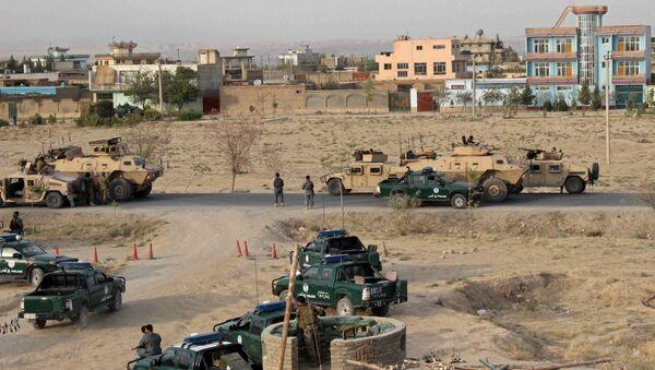 Afghan security forces take their positions during a gun battle in Kunduz city, northern Afghanistan September 29, 2015 - Sputnik Česká republika