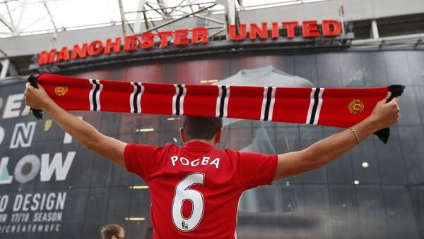 Fanoušek anglického fotbalového klubu Manchester United. Ilustrační foto - Sputnik Česká republika