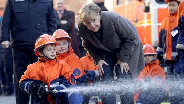 Německé kancléřka Merkelová s dětmi - Sputnik Česká republika