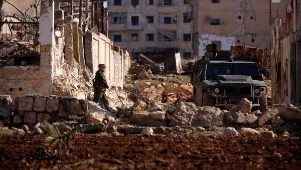 Ruský voják v Aleppu - Sputnik Česká republika