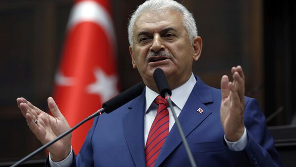 Turkey's Prime Minister Binali Yildirim addresses lawmakers at the parliament a day after he announced the details of an agreement reached with Israel. - Sputnik Česká republika
