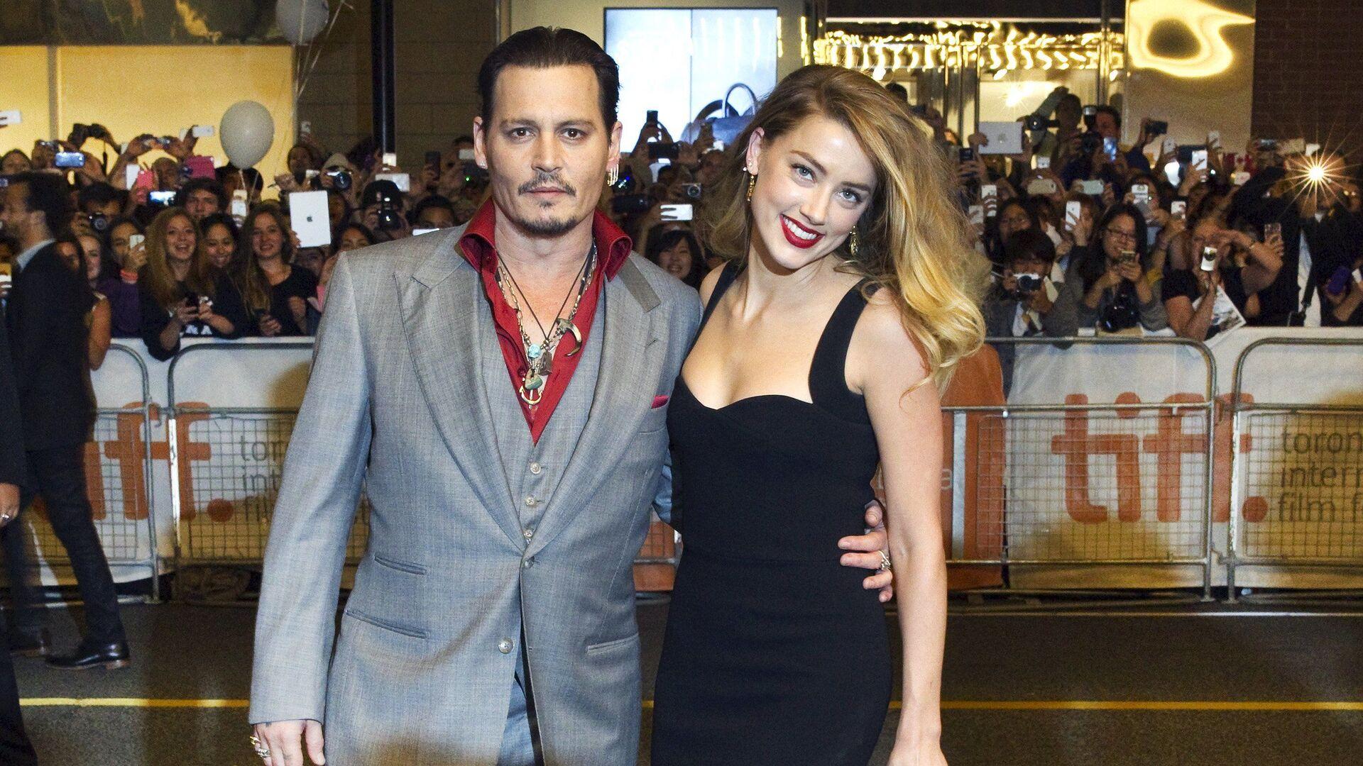 Herec Johnny Depp s Amber Heardovou - Sputnik Česká republika, 1920, 18.04.2021