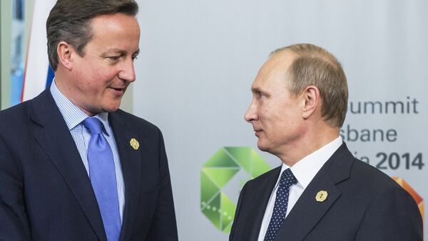 Prezident Ruska Vladimir Putin a ministerský předseda Velké Británie David Cameron - Sputnik Česká republika