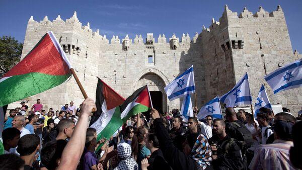 Izraelské a palestinské vlajky - Sputnik Česká republika