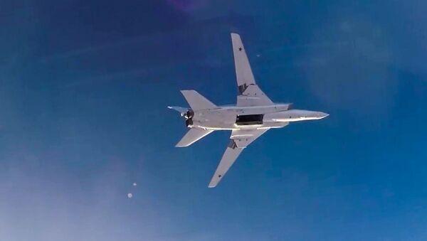 Bombardér Tu-22M3 během útoku v Sýrii - Sputnik Česká republika