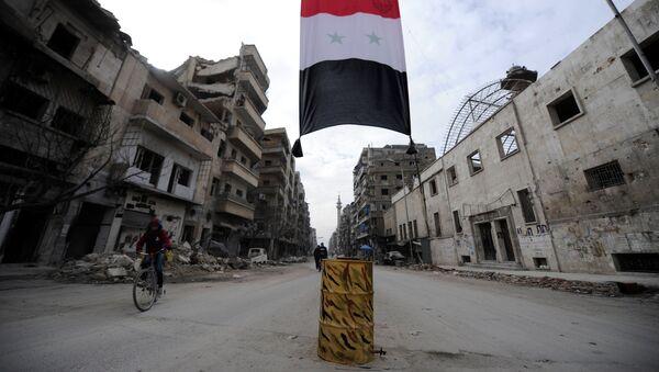 Syrská vlajka v Aleppu - Sputnik Česká republika