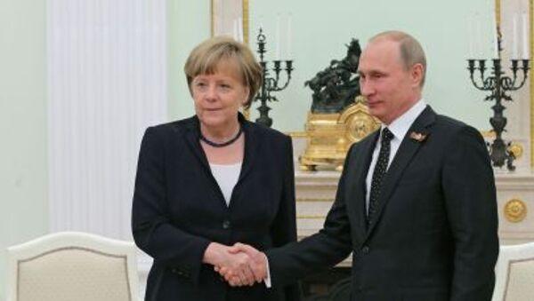 Ruský prezident Vladimir Putin s německou kancléřkou Angelou Merkelovou - Sputnik Česká republika