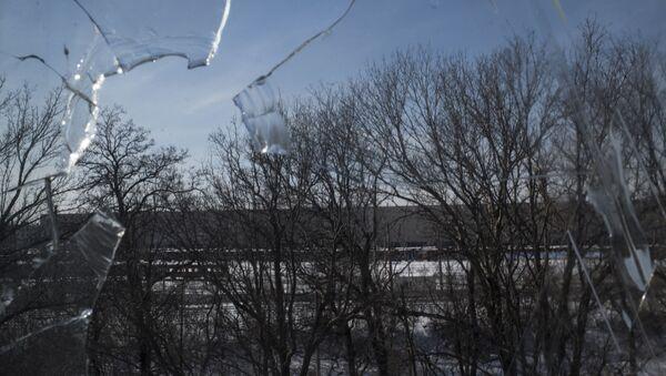 Rozbité okno v Doněcku - Sputnik Česká republika