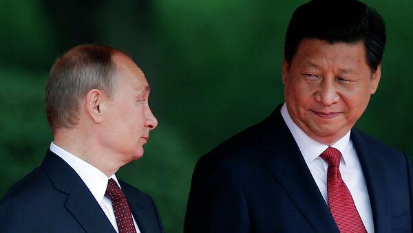 Ruský prezident Vladimir Putin a čínský prezident Si Ťin-pching - Sputnik Česká republika