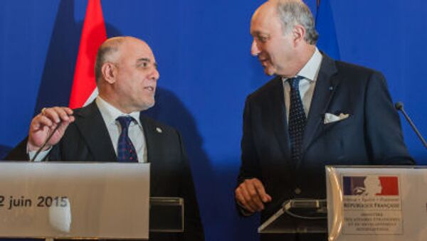 Premiér Iráku Haider al-Abadi a francouzský ministr zahraničních věcí Laurent Fabius - Sputnik Česká republika