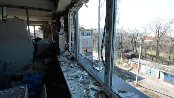 Následky ostřelování v obci Doněck-Severnyj v Doněcké oblasti - Sputnik Česká republika