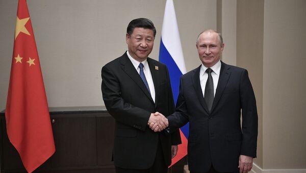 Ruský prezident Vladimir Putin a hlava ČLR Si Ťin-pching - Sputnik Česká republika