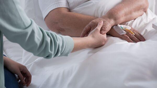 Žena postižená rakovinou. Ilustrační foto - Sputnik Česká republika