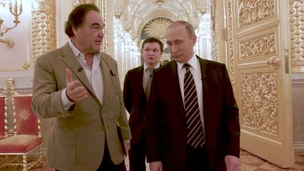 Oliver Stone a Vladimir Putin během interview - Sputnik Česká republika