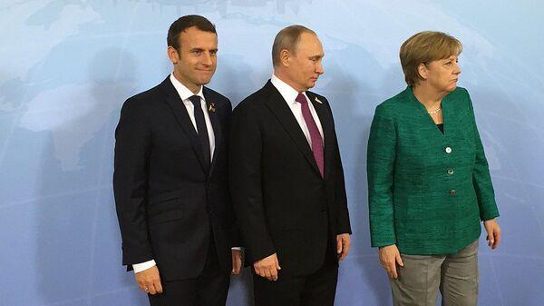 Schůzka ruského prezidenta Vladimira Putina s německou kancléřkou Angelou Merkelovou a s prezidentem Francie Emmanuelem Macronem - Sputnik Česká republika