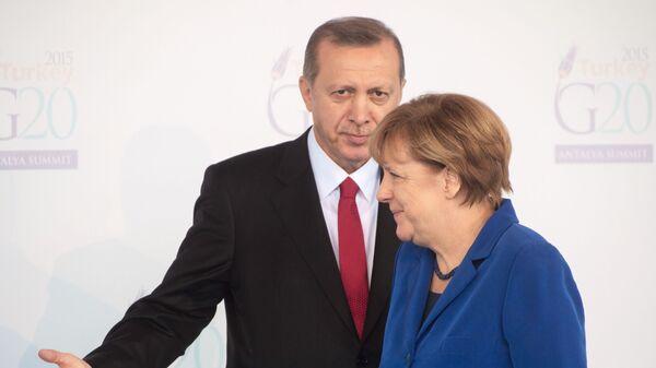 Turecký prezident Recep Tayyip Erdogan a německá kancléřka Angela Merkelová - Sputnik Česká republika