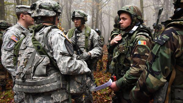 Američtí a moldavští vojáci na společných cvičeních - Sputnik Česká republika