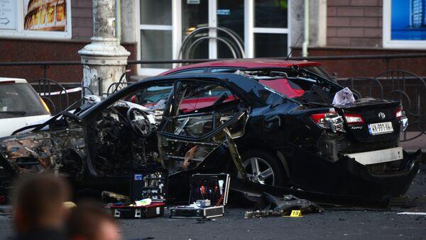 Poškozený v důsledku exploze automobil v Kyjevě - Sputnik Česká republika