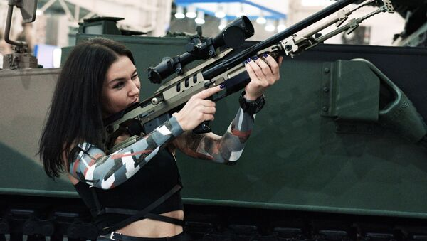 Dívka na kyjevské výstavě Zbraně a bezpečnost - Sputnik Česká republika