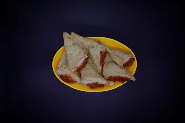 Severokorejské jídlo s názvem Injogogi-bab. - Sputnik Česká republika