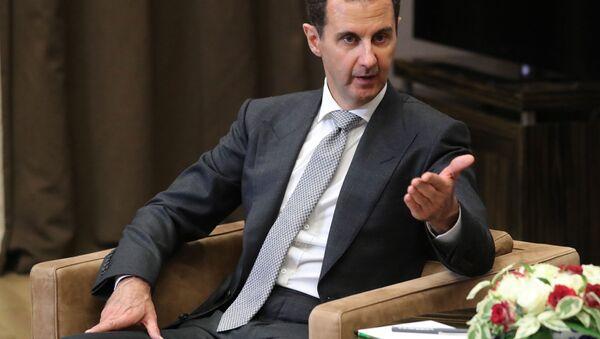 Syrský prezident Bašár Asad během schůzky s ruským prezidentem Vladimirem Putinem - Sputnik Česká republika