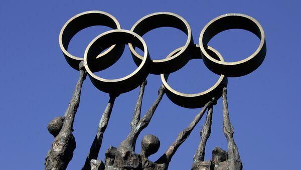 Socha před sídlem Mezinárodního olympijského výboru v Lausanne - Sputnik Česká republika