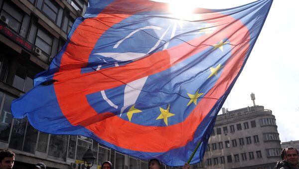 Demonstrace proti NATO v Bělehradu, Srbsko. - Sputnik Česká republika